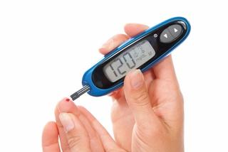 Blood sugar meter being used