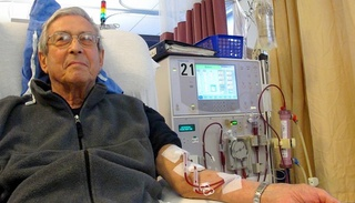 Man connected to hemodialysis machine