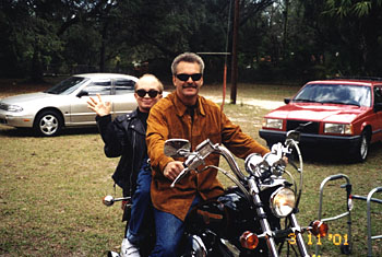 Bruce Schultz with friend on motorcycle